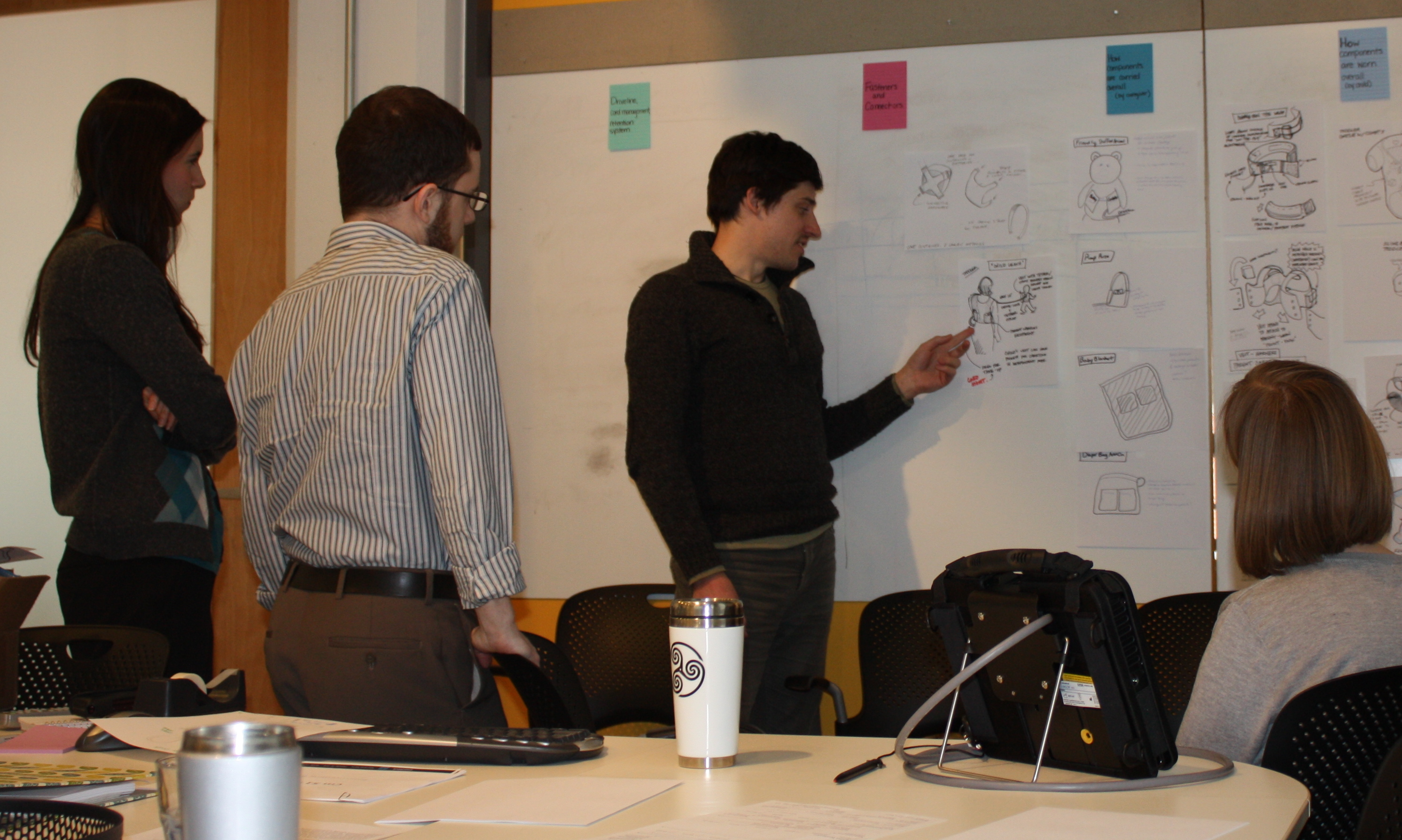 Designers presenting their concepts in a brainstorming session