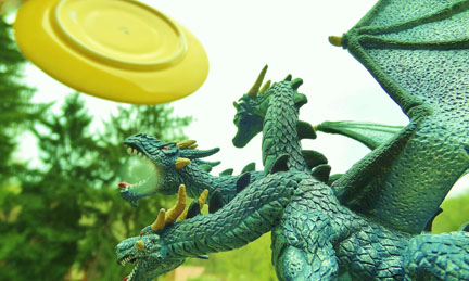 Dragon figurine with frisbee
