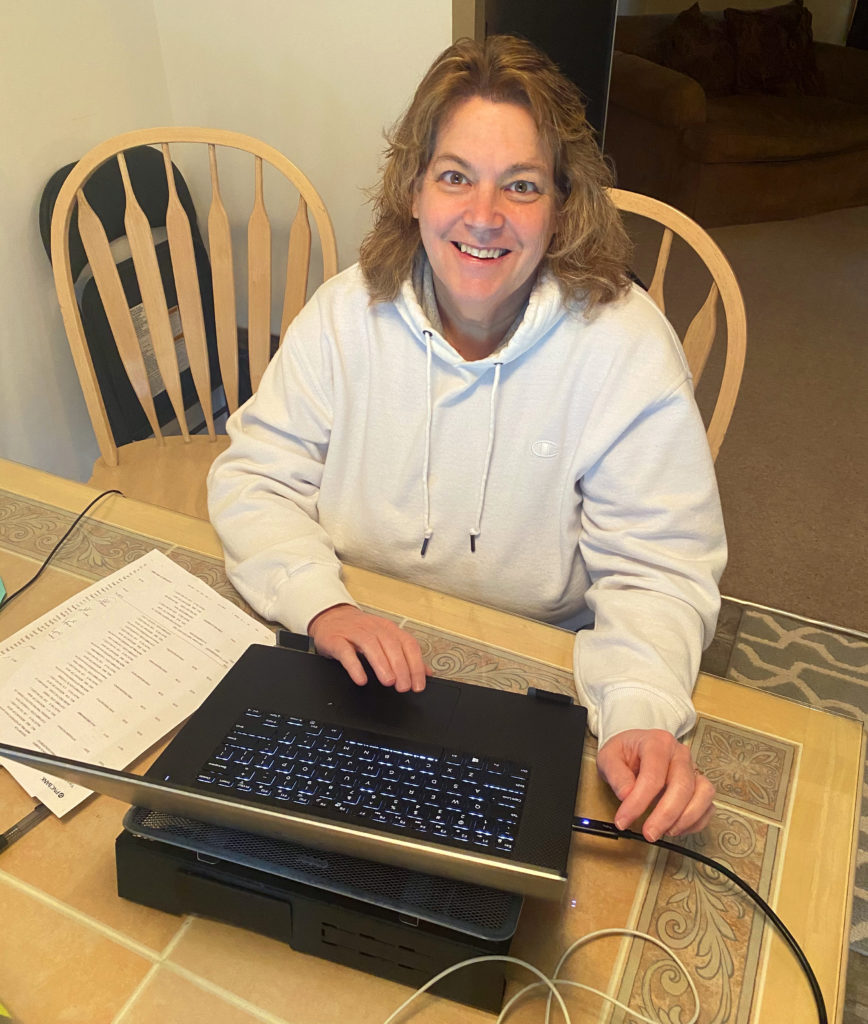 Daedalus Operations Manager Maureen Binnig at her kitchen table / home office.
